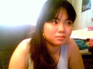 Femme asiatique mate des queues à la webcam